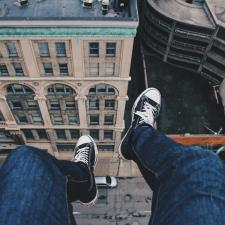 Sitting on edge of roof
